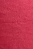 Red jeans surface Stock Images