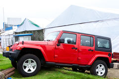 Red jeep on grass Royalty Free Stock Photo