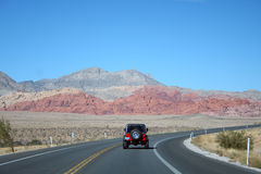 Red jeep, road, scenery Stock Image