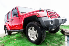Red jeep. Side view of the 4-wheel drive red jeep on the grass stock photos