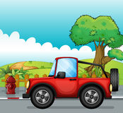 A red jeep at the street. Illustration of a red jeep at the street royalty free illustration