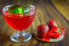 Red jelly with fruit. Stock Photo