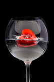 Red jelly heart in wine glass Stock Images