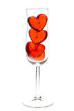 Red jelly hearts in champagne glass Royalty Free Stock Photos