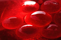 Red jelly-like globules Stock Photo