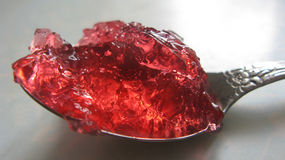 Red jelly on a spoon. Royalty Free Stock Photography