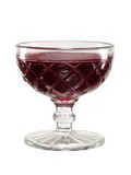 Red jelly in a vintage glass bowl. Sweet red jelly dessert in an old fashioned glass bowl royalty free stock image