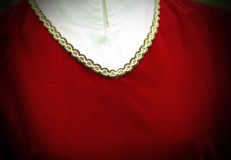 Red Jersey with golden decoration in medieval style Stock Photography