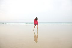 Red jersey woman at beach Stock Photos