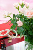 Red jewel box and pink roses Stock Images