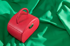 Red jewellery case on the green background Royalty Free Stock Photography