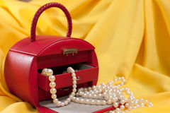Red jewellery case on the yellow background Royalty Free Stock Photography
