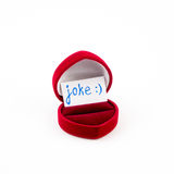 Red jewelry box Joke isolated on white Stock Photos