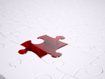 Red jigsaw. Standing out from the rest a red glass jigsaw peice Royalty Free Stock Photography