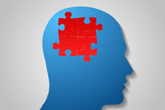 Red jigsaw on blue head Stock Images