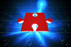 Red jigsaw piece on blue puzzle Royalty Free Stock Photo