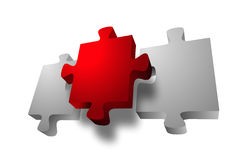 Red Jigsaw Puzzle Piece. Between two white pieces over white Royalty Free Stock Photo