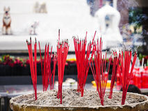 Red Joss Stick in the pot. For incense the holly god Stock Photo