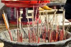 Red joss sticks burn in temple Stock Image