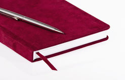 Red journal. And a pen over white background Royalty Free Stock Images