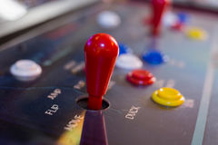 Red joystick with buttons on old arcade Stock Images