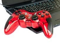Red joystick game controller on laptop . Stock Image