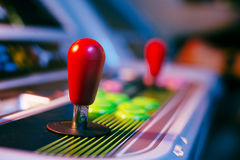 Red Joystick of an Old Arcade Video Game with background bokeh. Red Joystick of an Old Arcade Video Game with Blurred Background Royalty Free Stock Photos