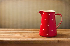 Red jug with dots