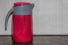 Red jug on table stock image