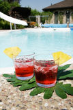 Red Juice. Two glasses with red cocktails by the pool Stock Photo