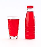 Red juice. In bottle and glass isolated Royalty Free Stock Photography