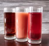 Juice in a glass on a dark table stock image