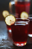 Red juice with lime slices Stock Images