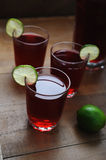 Red juice with lime slices Stock Image