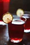 Red juice with lime slices Stock Photos