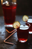 Red juice with lime slices Stock Photo