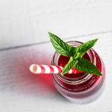 Red juice, mint and straws Royalty Free Stock Photography