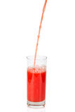 Red juice pouring in glass Royalty Free Stock Image