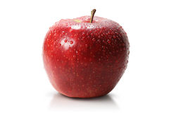 Red juicy apple. Juicy red apple sprinkled with water and  on a white background Royalty Free Stock Photo