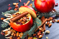 Red juicy apple with assorted nuts , raisins and cinnamon Stock Photos