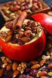 Red juicy apple with assorted nuts , raisins and cinnamon Stock Image