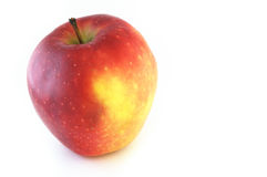 Red juicy apple isolated against white background. The ripe juicy red apple. Isolation on white Stock Images