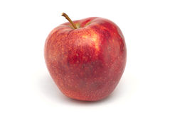 Red juicy apple on white. Background Stock Image