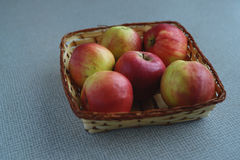 Red juicy apples. In the basket on the table Royalty Free Stock Images