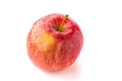 Red juicy macintosh apple. Shot from above of a ripe red juicy macintosh apple with a stem on a bright background Royalty Free Stock Photography