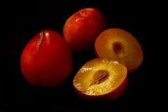 Red juicy plums stock photos