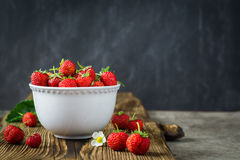 Red juicy strawberries in white bowl Royalty Free Stock Photo