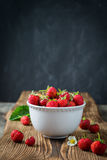 Red juicy strawberries in white bowl Stock Image
