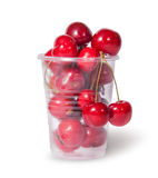 Red juicy sweet cherries in a plastic cup Stock Photo