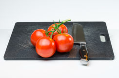 Red juicy tomatoes on Cutting Board Royalty Free Stock Photos